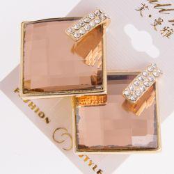 Гвоздики№85 оптом с большими персиковыми камнями на основе под золото.