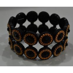 Браслет №469 черный со вставками в форме колечек под золото